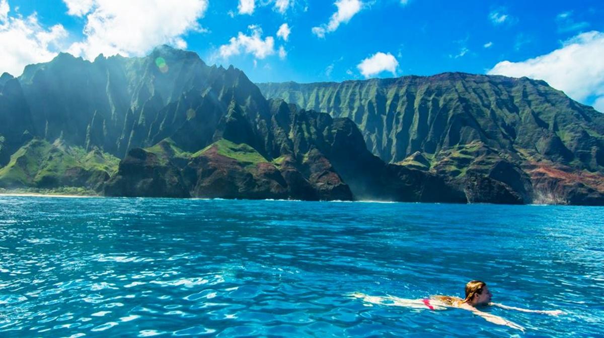 Swimming along the Na Pali Coast.
